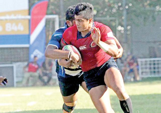 CR player Reeza Raffaideen makes a break against Navy