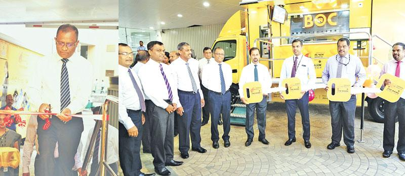 Left: Bank of Ceylon's CEO and General Manager Senarath Bandara opens the 'Branch on Wheel' mobile vehicle.     Right: The Bank's DGM Retail Banking Range 1 and Range 2 – D.M.L.B. Dassanayaka, DGM Product and Banking Development, M.J.P. Salgado, DGM Sales and Channel Management. C. Amarasinghe and CEO and General Manager Senarath Bandara with the Bank's Assistant General Managers of the Provinces who received mobile branch vehicles.