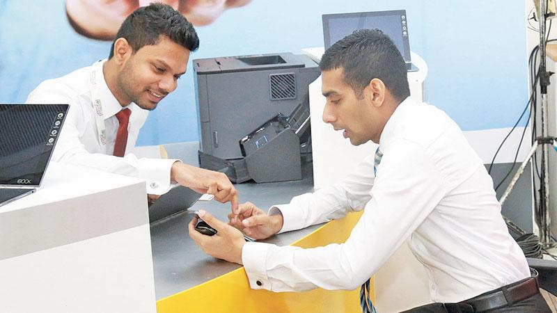 A customer applying for a loan through the Digital Loan system of the People's Bank.