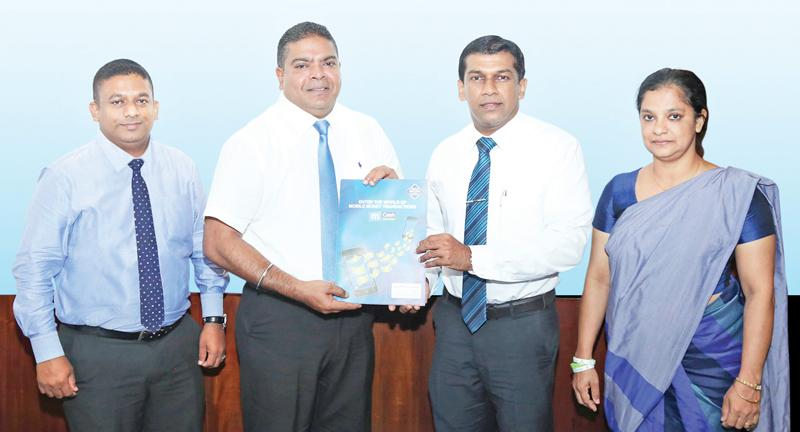 Mobitel CEO Nalin Perera (middle) exchanges the partnership agreement with Multi Finance CEO/Director Pushpike Jayasundera. Mobitel, General Manager, Mobile Financial Services, Kalhara Gamage and Multi Finance, Director, Legal, Champika Atapattu look on.