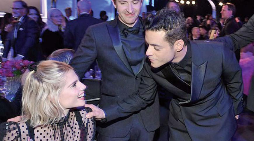 In love: Rami was ever the doting boyfriend as he tended to his girlfriend throughout the night