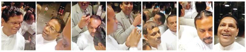 MPs, including Bandula Gunawardena, Dullas Alahapperuma, Wimal Weerawansa and Dayasiri Jayasekara in the lift