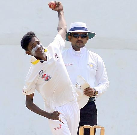 St. Peter's College bowler Kanishka Maduwantha bowls during his 10-wicket haul in their match against St. Benedict's College which ended in a draw at Kotahena yesterday (Pic by Saman Mendis)