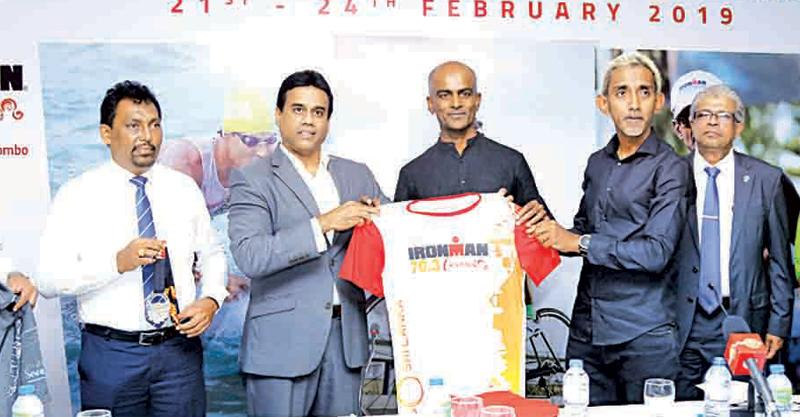 Chairman of the Sri Lanka Tourism Promotion Bureau Kishu Gomes (left) receives the official competitor's jersey from Pro-Am and Event Director Tanjan Thananayagam in the presence of Director Pro-Am Yasas Hewage. (Picture by Samantha Weerasiri