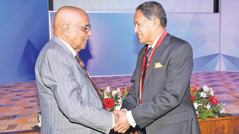 Founding member of CA Sri Lanka, Esmond Satarasinghe greets Dr. Kanag-Isvaran at the event.