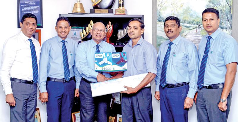 Kelani Cables PLC Director and CEO Mahinda Saranapala selling the first fan to Tecosa Electricals proprietor D.V. Prasanna Vithanage. From left: Brand Development Manager Channa Jayasinghe, Sales Manager, Electrical and Power, Rohana Wadduwage, Director/CEO, Kelani Cables, Mahinda Saranapala, proprietor of Tecosa Electricals, D.V. Prasanna Vithanage, General Manager, Marketing, Anil Munasinghe and Assistant Sales Manager, Dharshana Gamlath.