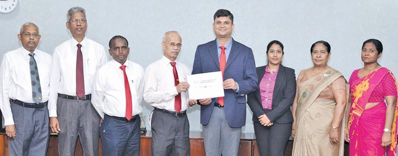 From left - Additional Finance Manager (Corporate), CEB, P. K. Kulatunga; Deputy General Manager (Information Technology), CEB, Dr. Rohantha Abeysekera;  Finance Manager, CEB, T. K. Liyanage; General Manager, CEB, S. D. W. Gunawardana; Country Manager, Sri Lanka and the Maldives, Mastercard, R. B. Santosh Kumar;  Senior Specialist - Account Management, Mastercard, Sheranga Perera; Additional General Manager (Corporate Strategy), CEB, N. W. Kumudinie Herath and System Analyst, CEB, Ms. Champika Hettiarachchi