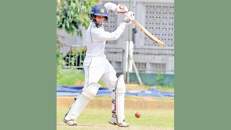 Nalanda College batsman Chamindu Wijesinghe drives a ball on his way to a half century against Maliyadeva College at Campbell Place yesterday
