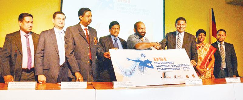 Managing Director D. Samson & Sons Sons Thusitha Rajapakse presents the sponsorship to the president of the Sri Lanka Volleyball Federation Ranjith Siyabalapitiya at the launch at the NOC  Auditorium.  Pic: Vipula Amerasinghe