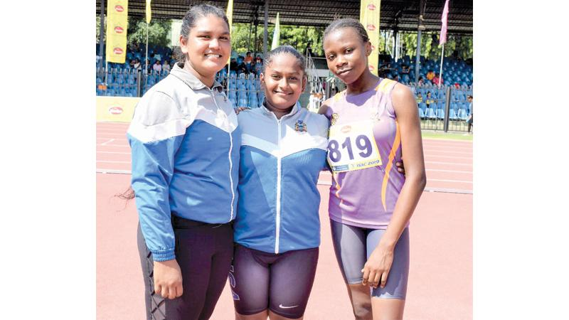 Malkethmi Silva (first place-centre), Ashritha Sunderasam (second place-left) and Promise Bassey (third place) after their event
