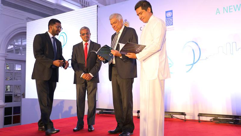 Prime Minister Ranil Wickremesinghe and Non-Cabinet Minister Sujeewa Senasinghe leaf through the First Year Review.