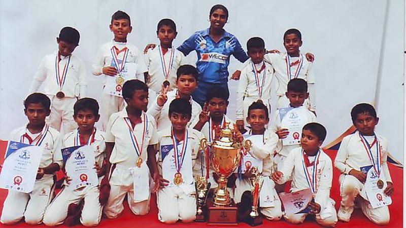 The champion CCC School of Cricket team comprising Tharun Ariyaratne Thesika Goonetilleke, Jahan Pathirana, Tharun Munaweera, Thanuk Mindaka, Methuka Galapitage, Nesandu Adambarage, Sinura Edirisinghe, Aiden Amaraweera, Dillow Ranaraj, Biddhija Atapattu, Vohara Kumanayake, Senuja Wanninayake, Niven Mendis and Uditha Navaratne with coach Rangika Fernando and the trophy