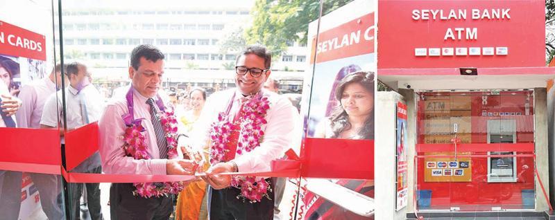 Seylan Bank Deputy General Manager, branches, Chitral de Silva opens the newly set up Godakawela branch.