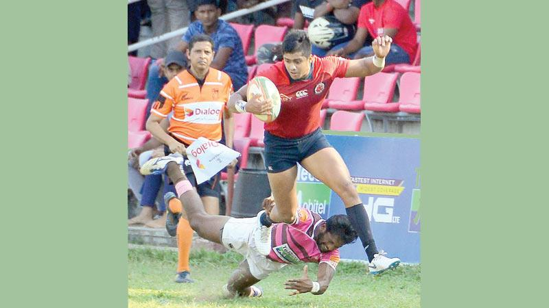 CR and FC winger Reza Refaideen breaks through a tackle against Havelocks in their Dialog Super Round rugby match at Havelock Park yesterday. Havelocks won the match 21-14 (Picture by Saman Mendis)