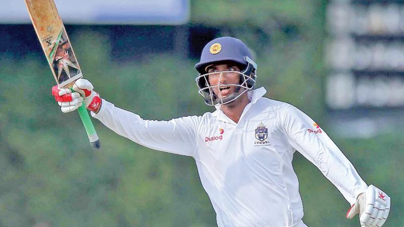 Santhush Gunatilleke celebrates his match-saving 161 Pic: Shan Rambukwella