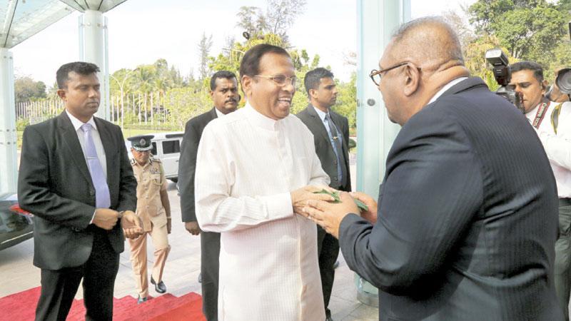 President  Maithripala Sirisena greets Mangala Samaraweera at the event