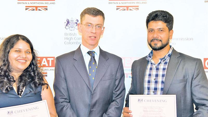 Raisa (L) and Mathanavasam (R) with UK High Commissioner James Dauris