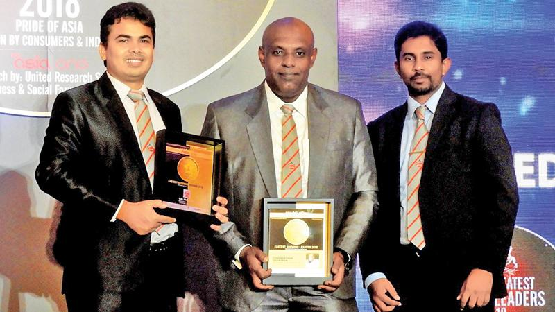 From left: Munchee Bangladesh CEO Shri Somanathaan Sridharan with the company's Brand Manager Ashraful Islam Durjoy and Finance Manager K.N.P. Shalinda.