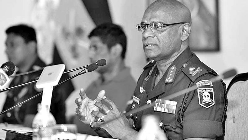 Army commander Lt Gen Mahesh Senanayake spells out plans to take badminton to all corners of the country as Sanjeewa Wijesekera a match referee listens attentively