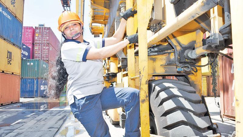 Harshani climbing her crane