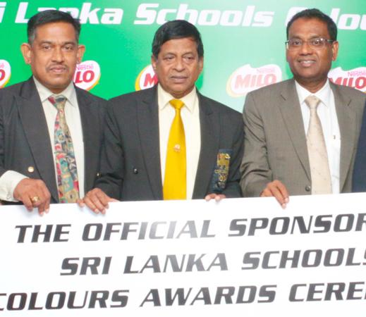 Vice President Corporate Affairs and Communication of Nestle Lanka Bandula Egodage (right) handing over the sponsorship cheque to Special Consultant Sports of the Ministry of Education Sunil Jayaweera in the presence of Athula Wijewardena the Deputy Director of Sports in the Ministry Of Education
