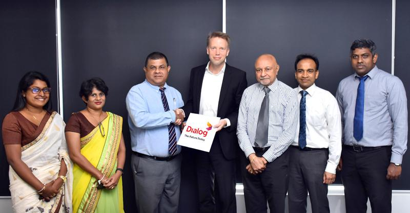 After the signing of the MoU. From left: Head, Computer Science, School of Computing, NIBM, Dr. Buddhima Subasinghe,  Director, School of Computing, NIBM, Gangani Wickramasinghe, Chairman, NIBM, Rohan Prithiviraj Perera, Vice President, Group Corporate Planning and Strategy, Dialog Axiata, Munesh David and Head, Business Intelligence Analytics, Dialog Axiata, Eranda Adikari.