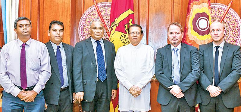 Officials of the two companies with President Maithripala Sirisena.