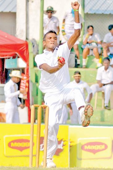 St. Sebastian's College paceman Thashik bowls during the second innings as he plucked two wickets in his first two balls (Pic by Saman Mendis)