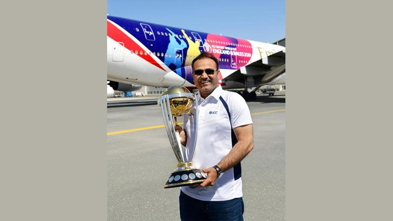 Former India cricketer and ICC Cricket World Cup 2011 winner Virender Sehwag with the trophy