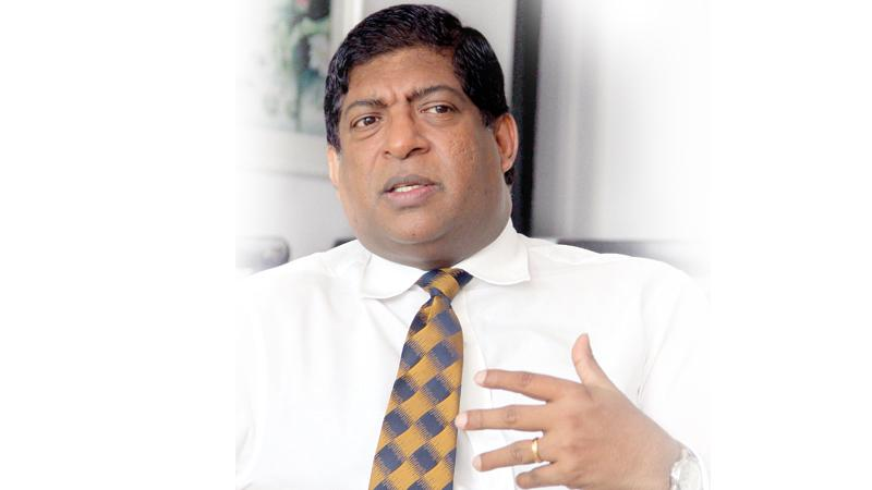 Power,  Energy and Business Development Minister Ravi Karunanayake