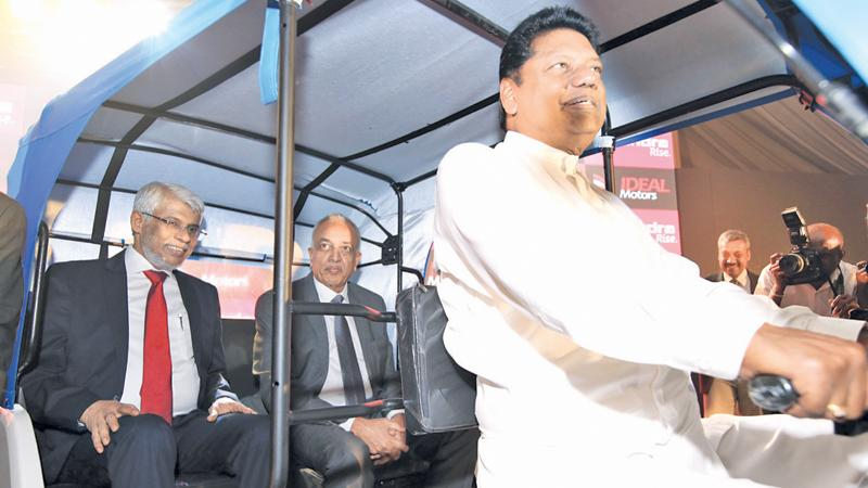 MP Kumara Welgama at the wheel while Development Strategies and International Trade Minister Malik Samarawickrema and former Chief Minister of the Eastern Province, Nazir Ahamed in the back seat of the Treo at the launch. Pic Vipula Amerasinghe
