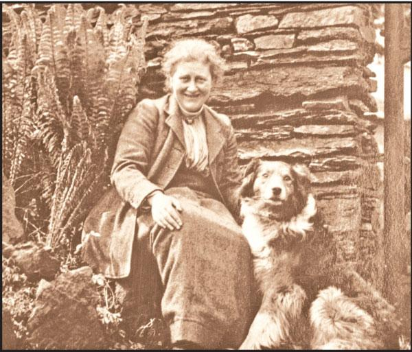 Beatrix Potter with dog Kep at the Hill top