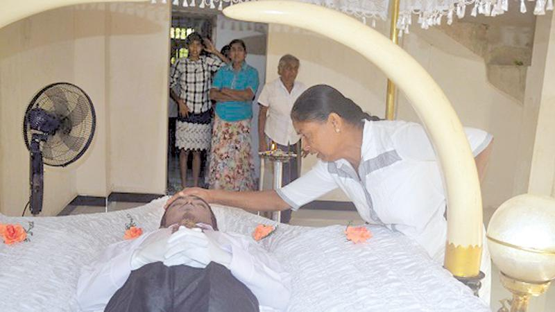 Nandawathie bids farewell to her only son.