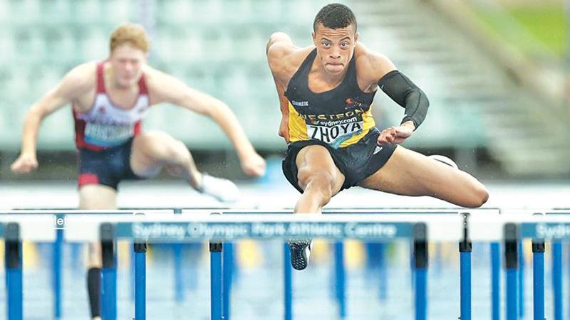Sasha Zhoya doing the hurdles