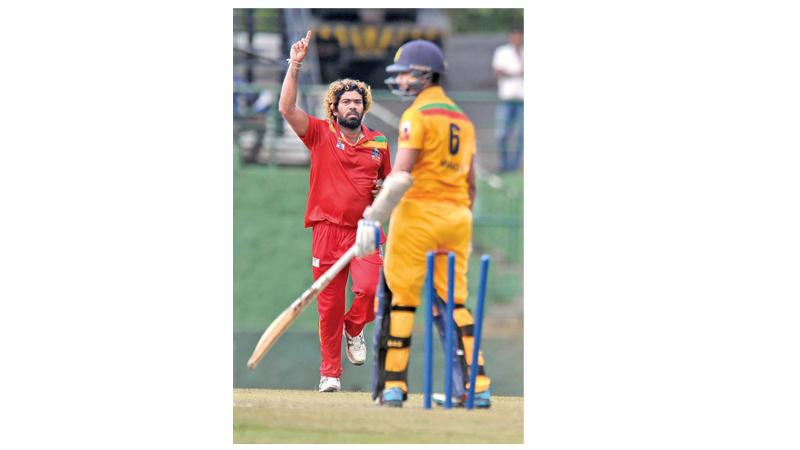 Lasith Malinga reacts after a wicket