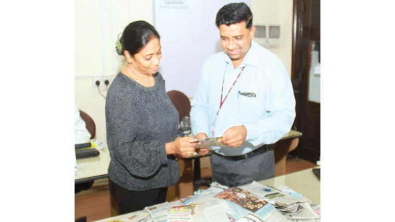 Samantha Jayaweera (right) Manager Production planning and Manjula Fernando, Senior News Reporter Sunday Observer, selecting the winners at Lake House office.