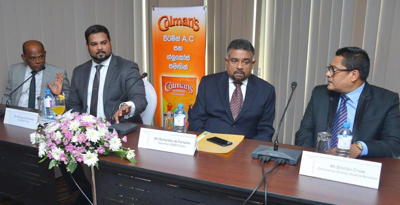 Reckitt Benckiser and CDDEF Group officials at the media briefing. Picture by Ranjith Asanka