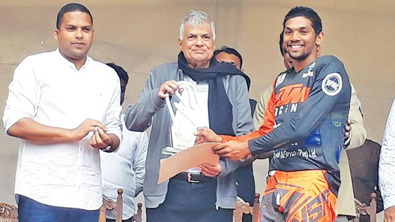 Champion Rider Jacques Gunawardena receiving the coveted Trophy from chief guest Prime Minister Ranil Wickramasinghe and guest of honour Sports Minister Harin Fernando