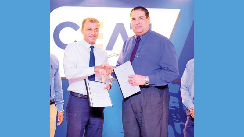 CEAT Kelani Managing Director Ravi Dadlani exchanges sponsorship agreements with SLADA President Rizvi Farouk