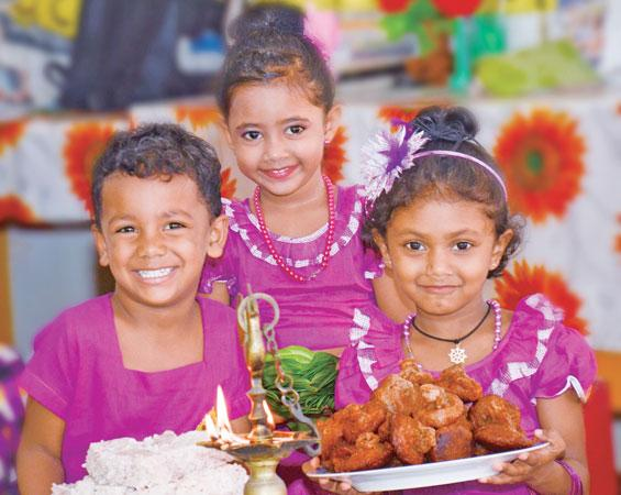 Now that the holidays are over, it's good to reflect on what you did. Here children with Avurudu sweetmeats. Pic: Wimal Karunarathne