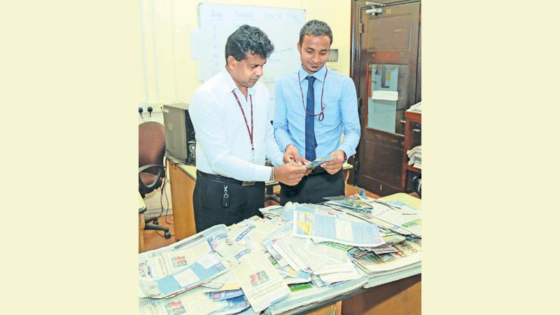 Eranga Vithana (right) Manager, ANCL Treasury and Marlon Karunaratne, Pictures Editor, picking the winners at the draw no 23 held at ANCL office. Pic: Shan Rambukwella