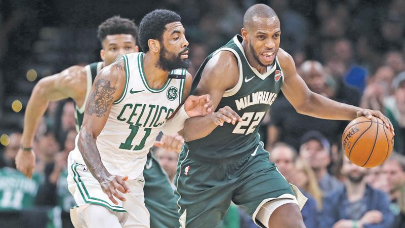 Khris Middleton #22 of the Milwaukee Bucks drives against Kyrie Irving #11 of the Boston Celtics during the second half of Game 3 of the Eastern Conference Semifinals of the 2019 NBA Playoffs  AFP
