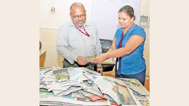 Senior Manager Financial Accounting and Tax, Gayanthi Wedage (right) and Associate Features Editor Dinamina, Anura Edirisuriya selecting the winners of the Readers Coupon draw of the Coupon No. 23 at Lake House.  Pic:Shan Rabukwella
