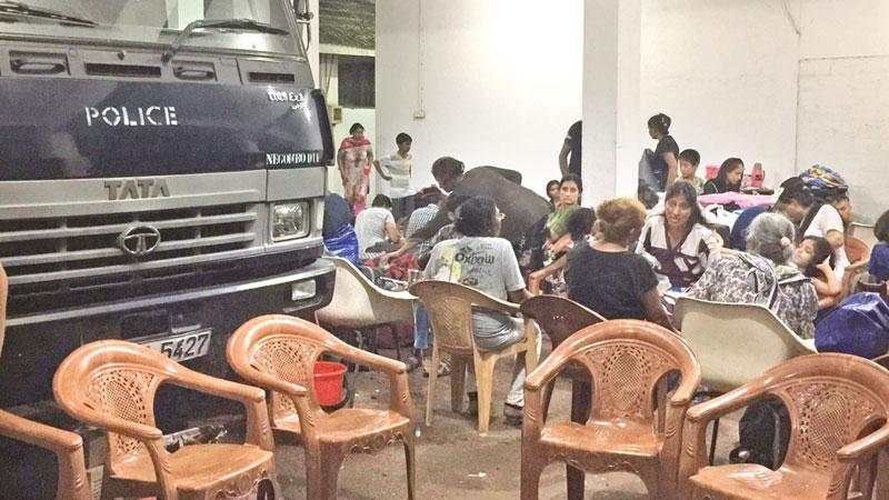 Refugees sheltering in the Negombo police garage  Pic : Ruki Fernando