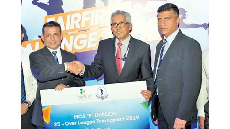 Managing Director and CEO Fairfirst Insurance the main sponsor Snajeeva Jha handing over the sponsor ship to President of MCA Roshan Iddamalgoda, also in the picture are Mahesh de Alwis Secretary MCA.  Pic: Shan Rambukwella