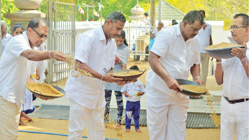 Moments captured at the sand paving ceremony with the Bank's CEO/ General Manager Senarath Bandara and members of the Corporate and Executive Management participating in the event.