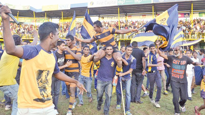 Flashback: Supporters of Royal College frolic after their team won the league title some years ago on their home ground. They'll be able to do the same this year at the Bradby while supporters of other teams will be locked in at the Sugathadasa Stadium in a blatant case of discrimination