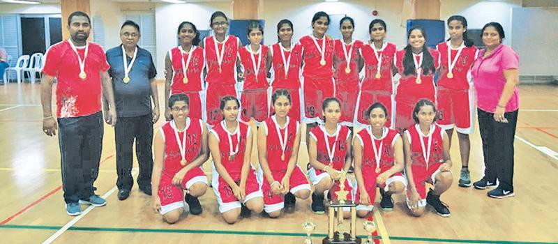 The Champion Kandy District Under 16 Girls Basketball team. Genuflecting from left: Sanjanie Kathiravel, Tharuni Kulatunge, Dinithi Chandrasekera, Shehani Egodagedara, Janithri  Lekamge, Enupama Gunawardena. Standing from left: Sajeera Gunaratne (Coach) DS Pingamage (Coach) Nadula Herath, K.Kirubakaran,Charunie Gunawardena, Koshila Weerakoon, Nimuth Lawangi, Amavi Dodanwela, Sewmini Ranaraja (Captain) Amina Fazeel, Aruni Hemakumari (Manager)