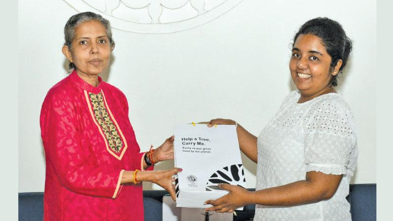 Shyamala Pushpanathan receiving her prize and Anuradha Nilmini Kumari' husband being handed his prize