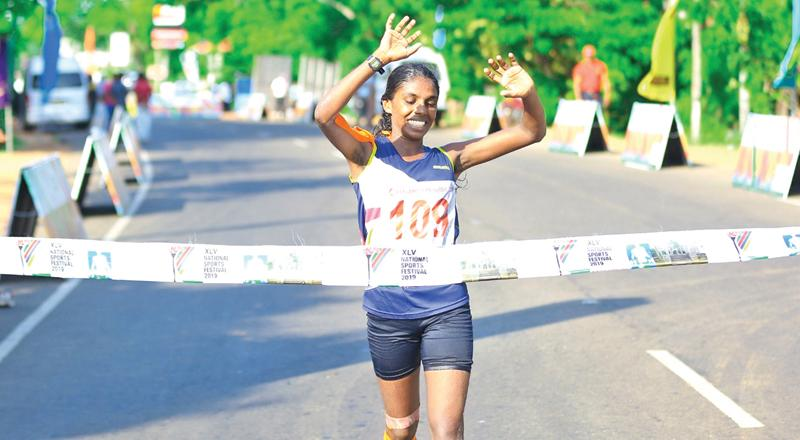 PB Gayani winning the women's walking race